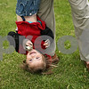 Rob Winner – rwinner@shawmedia.com<br /> <br /> Abbiggail Cowles, 2, holds a snow globe while being held upside down by her father, Patrick Cowles, as the two play outside their Sycamore home Tuesday. Abbiggail, who was diagnosed with autism in July 2011, attends three separate therapy sessions a week.<br /> <br /> Sycamore, Ill.<br /> Tuesday, April 24, 2012