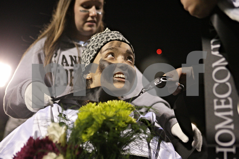 Rob Winner – rwinner@shawmedia.com<br /> <br /> Samantha Garcia receives a sash after being named the 2012 Kaneland homecoming queen in Maple Park, Ill., Friday, Oct. 12, 2012.