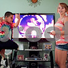 Kyle Bursaw – kbursaw@shawmedia.com<br /> <br /> Danika's cousin Vincint Lopez tries to get Danika to fight with him, using one of the Mortal Kombat films (background) as a motivation at Danika's mother's house in DeKalb on Tuesday, Aug. 28, 2012.