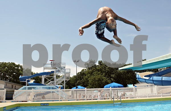 Rob Winner – rwinner@shawmedia.com<br /> <br /> Jadyn Thompson, 10 of DeKalb, performs a backflip off a diving board while spending the afternoon at the Hopkins Park pool in DeKalb, Ill., on Friday, June 15, 2012.