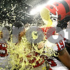 Kyle Bursaw – kbursaw@shawmedia.com<br /> <br /> Northern Illinois kicker Tyler Wedel (26) gives head coach Dave Doeren, defensive lineman Nabal Jefferson (99) and Demetrius Stone (19) a Gatorade shower after the Huskies 44-37 overtime victory over Kent State in the MAC conference championship game at Ford Field in Detroit, Mich. on Friday, Nov. 30, 2012.