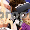 Kyle Bursaw – kbursaw@shawmedia.com<br /> <br /> Kaylee Skeens, 4, talks to her mother, Suzanne Skeens, while Suzanne gets a free massage from Stacy Vermeis of  Sheedy Chiropractic during the Community Expo at DeKalb High School on Tuesday, April 3, 2012.
