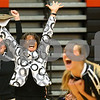 Kyle Bursaw – kbursaw@shawmedia.com<br /> <br /> Sycamore coach Debbie Klock celebrates along with an assistant coach and Ratasha Garbes (foreground) and Mattie Hayes (12) as Sycamore defeats DeKalb 28-26, 25-21at DeKalb High School on Thursday, Oct. 4, 2012. The Spartans lost the five previous matches against the Barbs.
