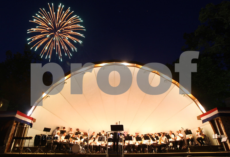 Kyle Bursaw – kbursaw@shawmedia.com<br /> <br /> The DeKalb Municipal Band plays as fireworks explode over the band shell at Hopkins Park in DeKalb, Ill. on Wednesday, July 4, 2012.