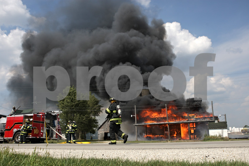 Rob Winner – rwinner@shawmedia.com<br /> <br /> Firefighters respond to a barn fire located on West Lincoln Highway in DeKalb, Ill., Saturday, Aug. 25, 2012.