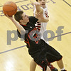Rob Winner – rwinner@shawmedia.com<br /> <br /> Indian Creek's Noah Holm (25) puts up a shot good for two over Yorkville's Taylor Carter in the second quarter at the Plano Christmas Classic on Saturday, Dec. 29, 2012. Yorkville defeated IC, 69-65.