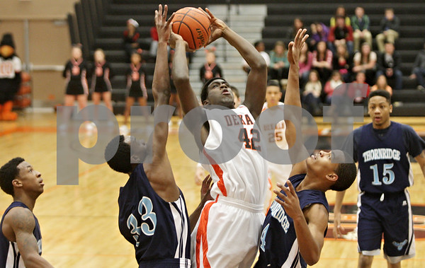 Rob Winner – rwinner@shawmedia.com<br /> <br /> DeKalb's Justin Love (42) puts up a shot in the first quarter at the Chuck Dayton Holiday Tournament in DeKalb, Ill., Thursday, Dec. 27, 2012. Thornridge defeated DeKalb, 64-66.
