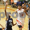 Rob Winner – rwinner@shawmedia.com<br /> <br /> DeKalb's Andre Harris (22) makes a pass in the fourth quarter at the Chuck Dayton Holiday Tournament in DeKalb, Ill., Thursday, Dec. 27, 2012. Thornridge defeated DeKalb, 64-66.