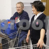 Rob Winner – rwinner@shawmedia.com<br /> <br /> Volunteer Betty Koehling (left) shares a laugh with Salvation Army Captain Alisha Cho while working at the food pantry at the Salvation Army in DeKalb, Ill., Thursday, Dec. 13, 2012.