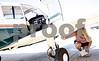 Morgan Dirienzo, 17, does pre-flight checks before one of her training sessions with Fly America Instructor Max Tucker on Wednesday, Aug. 1, 2012. (Kyle Bursaw - kbursaw@shawmedia.com)