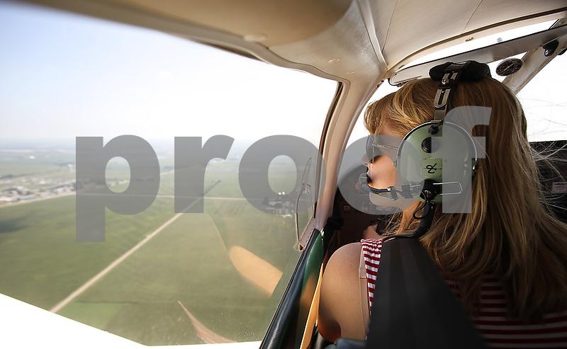 Morgan Dirienzo, 17, glances toward the DeKalb Taylor Municipal Airport as she practices different types of landings flying a small single-engine plane on Wednesday, Aug. 1, 2012. (Kyle Bursaw - kbursaw@shawmedia.com)