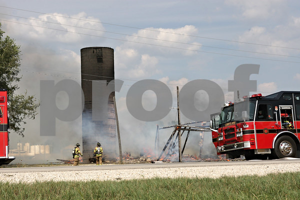 Rob Winner – rwinner@shawmedia.com<br /> <br /> Firefighters contain a barn fire located on West Lincoln Highway in DeKalb, Ill., Saturday, Aug. 25, 2012.