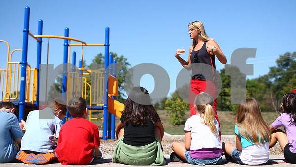Kyle Bursaw – kbursaw@shawmedia.com<br /> <br /> Kelly Wright discusses playground rules with her first grade class at the start of their recess at North Grove Elementary on Wednesday, Aug. 22, 2012.