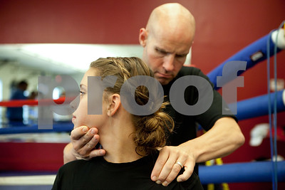 Kyle Bursaw – kbursaw@shawmedia.com  R.W. Brown, owner of the Academy of Human Performance, uses trigger point therapy to loosen up some of Danika's muscles at the beginning of a session in Aurora, Ill. on Tuesday, July 10, 2012.