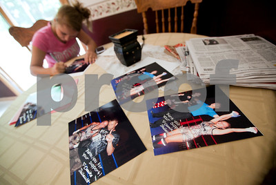 Kyle Bursaw – kbursaw@shawmedia.com  Danika autographs pictures taken just after her victory in the championship kickboxing match in the flyweight division for 14-year-old girls in Orlando to give to her sponsors at her mom's house on Monday, July 30, 2012.