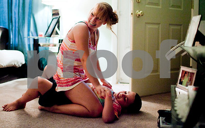 Kyle Bursaw – kbursaw@shawmedia.com  Danika pins her cousin Vincint Lopez to the ground after he told Danika she had a crooked nose and a high belly button at Danika's mother's house in DeKalb on Tuesday, Aug. 28, 2012. Not Danika's first time wrestling in the house, she once threw her older sister into the wall leaving a large dent.