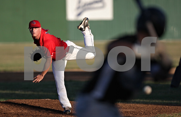 Rob Winner – rwinner@shawmedia.com<br /> <br /> DeKalb County pitcher Brody Justice delivers a pitch to DuPage batter Brian Rodemoyer in the top of the first inning during a game in Sycamore Thursday evening.