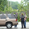 Kyle Bursaw – kbursaw@shawmedia.com<br /> <br /> Vinnie Laudicina (center) and Lieutenant Paul Rubeck (right), both from the Sycamore Fire Department, talk with a property owner while stationed to keep people away from the downed power lines on the 200 block of North Cross Street in Sycamore, Ill. on Tuesday, July 24, 2012.