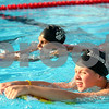 Kyle Bursaw – kbursaw@shawmedia.com<br /> <br /> Sharron Isola and Kristin Van Oost, both 18, swim with kickboards in the Hopkins Park pool on Friday, July 13, 2012. Isola and Van Oost will compete in the YMCA National Championships in Atlanta on July 23 to 27.