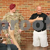 Rob Winner – rwinner@shawmedia.com<br /> <br /> Army Spc. Tyler Ryan (left) and his father  Mike Ryan thank supporters outside Sullivan's Tavern in DeKalb Tuesday.