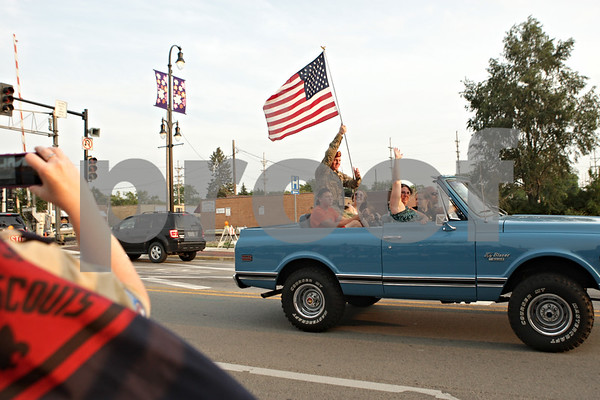 Rob Winner – rwinner@shawmedia.com<br /> <br /> Army Spc. Tyler Ryan is welcomed home by well wishers along Lincoln Highway in downtown DeKalb Tuesday evening.