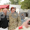 Rob Winner – rwinner@shawmedia.com<br /> <br /> Army Spc. Tyler Ryan (right) poses for a photograph with his father Mike Ryan outside Sullivan's Tarvern in DeKalb Tuesday night.