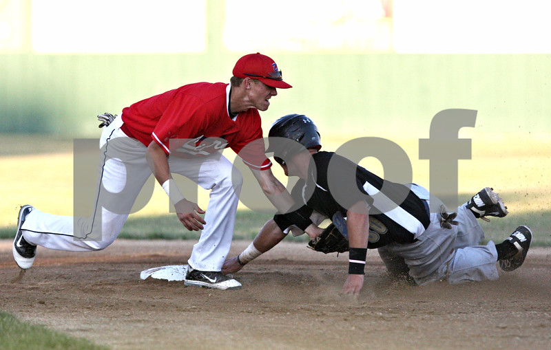 Rob Winner – rwinner@shawmedia.com<br /> <br /> DuPage baserunner Brian Rodemoyer (right) is tagged out by DeKalb County shortstop Brent Turner during a steal attempt in the top of the second inning in Sycamore Thursday evening.