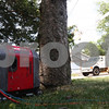 Kyle Bursaw – kbursaw@shawmedia.com<br /> <br /> A generator, owned by Michael Degand, powers his and his neighbor's homes on the 200 block of North Cross Street as ComEd works in the street to repair the damaged power lines on Wednesday, July 25, 2012.
