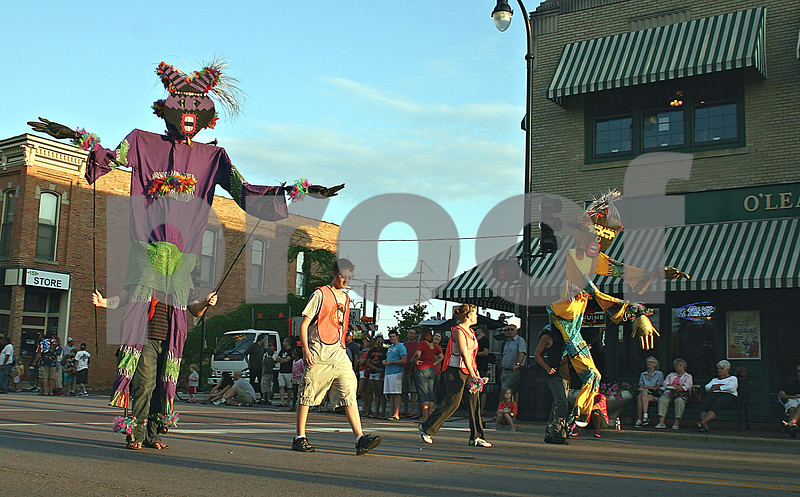 Big puppets entertain crowds during the third annual Kishwaukee Fest parade in downtown DeKalb Friday evening.<br /> <br /> By Nicole Weskerna - nweskerna@shawmedia.com