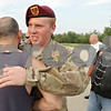 Rob Winner – rwinner@shawmedia.com<br /> <br /> Army Spc. Tyler Ryan (right) is welcomed home by Genoa American Legion Rider George Limberis before an escort through downtown DeKalb Tuesday evening.