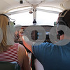 Kyle Bursaw – kbursaw@shawmedia.com<br /> <br /> Fly America Flight Instructor Max Tucker simulates instrument failure by covering them with scrap paper for Morgan Dirienzo, 17, during one of their flight sessions on Wednesday, Aug. 1, 2012.