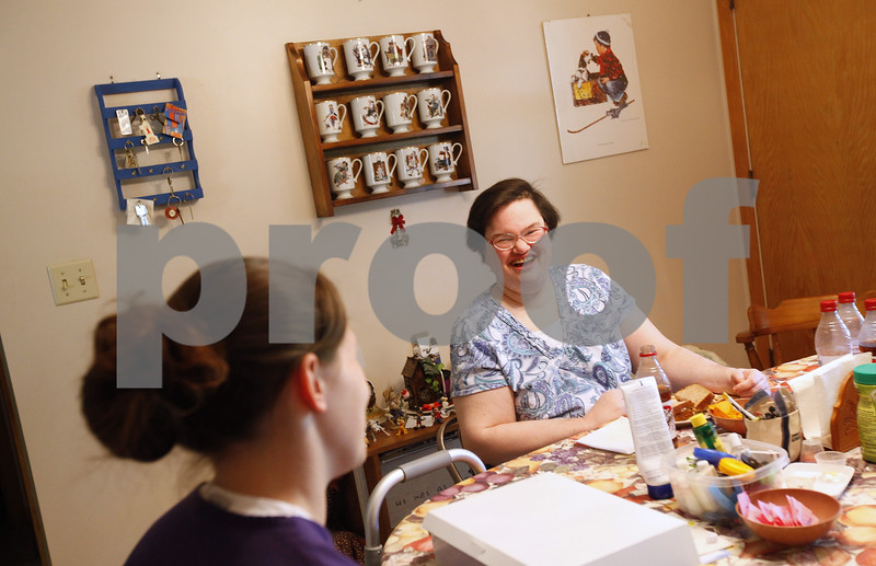Kyle Bursaw – kbursaw@shawmedia.com<br /> <br /> Colleen Snyder shares a laugh with Ashley Neumann, a certified nursing assistant with Visiting Angels, after Snyder jokingly offered Neumann some of her medication to eat for lunch <br /> at Snyder's home on Friday, Aug. 3, 2012. Neumann prepared lunch for Colleen and her mother May Snyder who both need in-home care.
