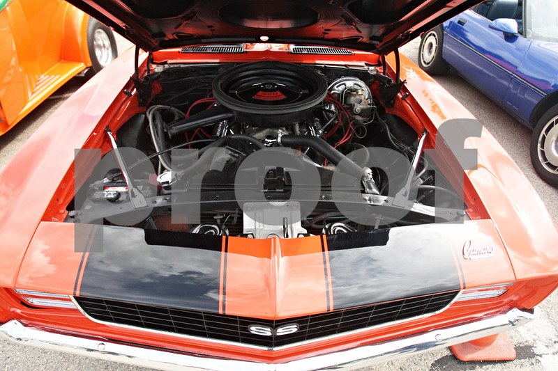 Rob Winner – rwinner@shawmedia.com<br /> <br /> A view from under the hood of a 1969 Chevy Camaro SS/RS during the Turning Back Time Weekend Cruise Night in Sycamore, Ill., Saturday, July 28, 2012.