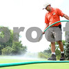 Kyle Bursaw – kbursaw@shawmedia.com<br /> <br /> Steve Tritt, the assistant superintendent at Sycamore Golf Course, waters spots on the putting green that need a little extra attention beyond what they get from the course's sprinkler system on Monday, July 23, 2012.