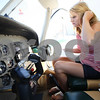 Kyle Bursaw – kbursaw@shawmedia.com<br /> <br /> Morgan Dirienzo, 17, does pre-flight checks before one of her training sessions with Fly America Instructor Max Tucker on Wednesday, Aug. 1, 2012.