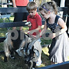 Henry Manning, 4, of Chicago, and Jersy Crabtree, 4, of Belvidere, pet a goat Saturday at the second annual Farm Fest in Genoa.<br /> <br /> By Nicole Weskerna - nweskerna@shawmedia.com