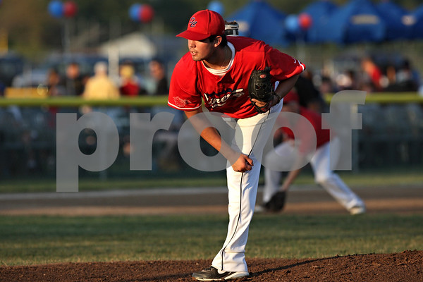Rob Winner – rwinner@shawmedia.com<br /> <br /> DeKalb County starting pitcher David Deliz delivers a pitch in the top of the first inning during Game 1 of the Midwest Collegiate League championship series against Northwest Indiana in Sycamore, Ill., Friday, Aug. 3, 2012.