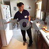 Kyle Bursaw – kbursaw@shawmedia.com<br /> <br /> Ashley Neumann, a certified nursing assistant with Visiting Angels, prepares lunch for May and Colleen Snyder at their DeKalb home on Friday, Aug. 3, 2012.
