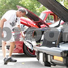 Rob Winner – rwinner@shawmedia.com<br /> <br /> Jim Landherr of Waukesa, Wis. wipes of the front of his 1967 Oldsmobile 442 during the Turning Back Time Weekend Cruise Night in Sycamore, Ill., Saturday, July 28, 2012.