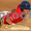 Rob Winner – rwinner@shawmedia.com<br /> <br /> DeKalb County baserunner Brent Turner slides safely back to first after a pick off attempt in the bottom of the first inning during Game 1 of the Midwest Collegiate League championship series against Northwest Indiana in Sycamore, Ill., Friday, Aug. 3, 2012.