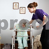 Kyle Bursaw – kbursaw@shawmedia.com<br /> <br /> Ashley Neumann, a certified nursing assistant with Visiting Angels, helps May Snyder into a chair in her DeKalb home on Friday, Aug. 3, 2012.