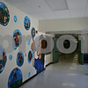 Jeff Engelhardt – jengelhardt@shawmedia.com<br /> West Elementary Principal Bradley Barnhardt looks at the mural art teacher Heather Havlicek created during the summer. The mural promotes the school's core values.