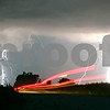 Rob Winner – rwinner@shawmedia.com<br /> <br /> Brake lights from a pickup truck heading westbound on Owens Road near the intersection of Somonauk and Owens Roads in Pierce Township can be seen as lightning strikes during a storm Wednesday, July 18, 2012.