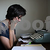 Rob Winner – rwinner@shawmedia.com<br /> <br /> Inside her DeKalb apartment, Ariel Finney, a senior at Northern Illinois University, pauses for a moment while using a typewriter to format one of three poems that will be displayed at the Ben Gordon Center Art Therapy Show in DeKalb from July 23 to 27.<br /> <br /> DeKalb, Ill.<br /> Wednesday, July 18, 2012