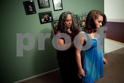 Kyle Bursaw – kbursaw@shawmedia.com  Rena Thibault pins her daughter Danika's dress in their DeKalb living room while getting ready for an end of the year dance for eighth-graders at Clinton Rosette Middle School on Thursday, May 31, 2012.