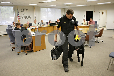 Rob Winner – rwinner@shawmedia.com  Genoa Police Sgt. Robert Smith and Kane, Genoa's new police dog, finish up their demonstration for city council members Tuesday evening. The purchase of the K-9 and its training was paid for by donations and fundraisers.