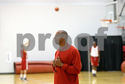 Rob Winner – rwinner@shawmedia.com  Northern Illinois basketball coach Mark Montgomery watches his players shoot free throws during a practice Tuesday in DeKalb.