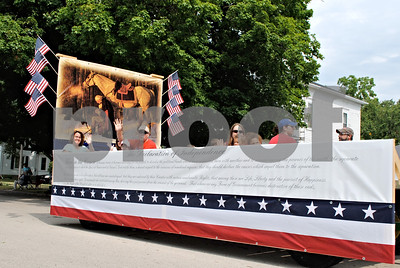 A float displaying the Declaration of Independence rolls through Shabbona's parade, which kicked off the 11th annual Shabbona Hometown Festival Saturday.  By Nicole Weskerna - nweskerna@shawmedia.com