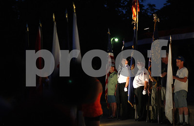 Kyle Bursaw – kbursaw@shawmedia.com  Members of the honor guard present the colors before the fireworks show at Hopkins Park on Wednesday, July 4, 2012.