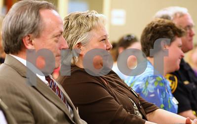 Kyle Bursaw – kbursaw@shawmedia.com  Public Defender Regina Harris (center) looks on at the Drug/DUI Court graduation on Friday, June 8, 2012.